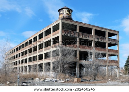 DETROIT, MI-MAY, 2015:  Abandoned factory in Detroit, Michigan. The building has been stripped of anything of value by looters.   - stock photo