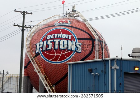 DETROIT, MI-MAY, 2015:  Detroit Pistons logo and basketball painted on an oil storage tank.   - stock photo