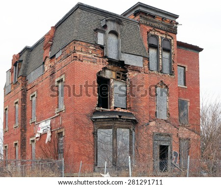 DETROIT, MI-MAY, 2015:  One of thousands of empty and abandoned houses in Detroit.  This was a 3 story luxury home many years ago.  - stock photo