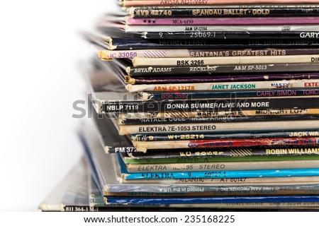 DETROIT, MI - September 01. 2014. Pile of various old dusty album sleeves. Vinyl LP Records. - stock photo