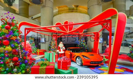 DETROIT, MI/USA - DECEMBER 18: Santa Claus stands next to a 2014 Chevrolet (Chevy) Corvette and Christmas tree, on public display, at the GM (General Motors) Renaissance Center building. - stock photo