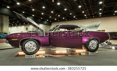 DETROIT, MI/USA - FEBRUARY 27, 2016: A 1971 Plymouth 'cuda (Barracuda) interpretation, on display at the Detroit Autorama, a showcase of custom and restored cars. - stock photo