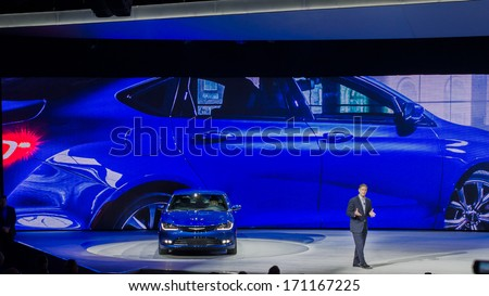 DETROIT, MI/USA - JANUARY 13: Al Gardner, Chrysler Brand CEO, announces the 2014 Chrysler 200 at the North American International Auto Show (NAIAS) on January 13, 2014, in Detroit, Michigan. - stock photo
