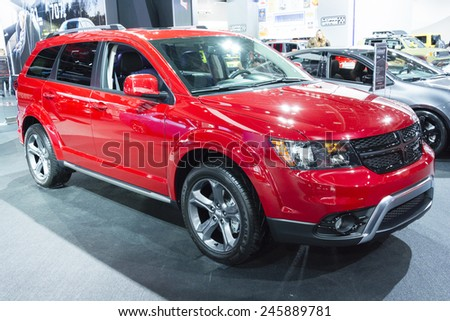 DETROIT, MI, USA - JANUARY 12, 2015: Dodge Journey on display during the 2015 Detroit International Auto Show at the COBO Center in downtown Detroit. - stock photo