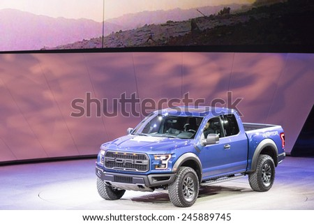 DETROIT, MI, USA - JANUARY 12, 2015: Ford F150 Raptor on display during the 2015 Detroit International Auto Show at the COBO Center in downtown Detroit. - stock photo