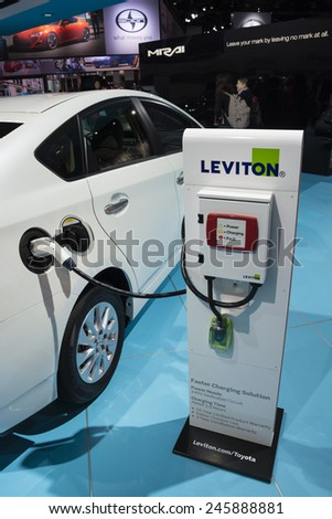 DETROIT, MI, USA - JANUARY 12, 2015: Toyota Prius and the Leviton charging station on display during the 2015 Detroit International Auto Show at the COBO Center in downtown Detroit.