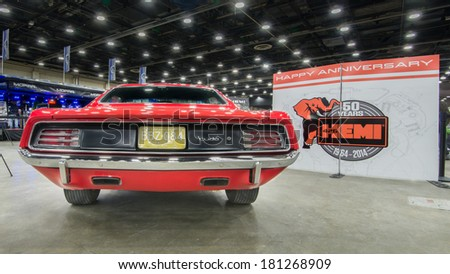 """DETROIT, MI/USA - MARCH 9, 2014: A 1970 Plymouth Hemi 'Cuda (Barracuda), on display at the Detroit Autorama. Part of the """"50 Years of Hemi"""" exhibit. - stock photo"""