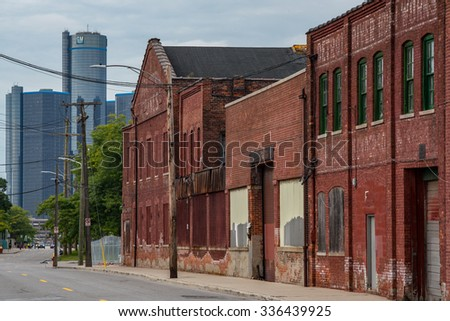 Detroit, MI, USA Sept 18, 2015.  Boarded up brick industrial buildings along Atwater Street in Detroit. - stock photo