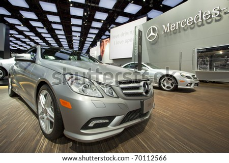 DETROIT, MICHIGAN - JANUARY 18: A new E 550 Mercedes Benz is on display at the 2011 North American International Auto Show on January 18, 2011 in Detroit, Michigan. - stock photo