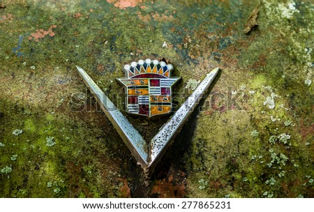 DETROIT, MICHIGAN - May 11, 2015: Old logo from a vintage Cadillac sedan. The logo has changed over the years, but the original was based on the coat of arms for Le Sieur Antoine De La Mothe Cadillac. - stock photo