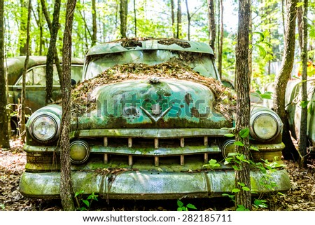DETROIT, MICHIGAN - May 11, 2015: Wreck of an old Cadillac. The logo has changed, but this original was based on the coat of arms for Le Sieur Antoine De La Mothe Cadillac, the man who founded Detroit - stock photo