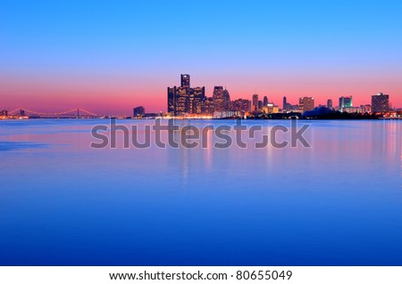 Detroit, Michigan Skyline at Sunset overlooking the Detroit River from Belle Isle Park with a view of the Ambassador Bridge. HDR from five exposures. - stock photo