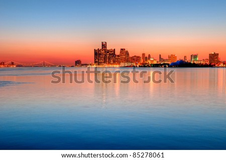 Detroit, Michigan Skyline at Sunset overlooking the Detroit River from Belle Isle Park with a view of the Ambassador Bridge. - stock photo