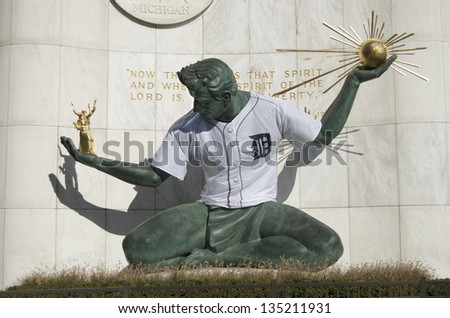 DETROIT - OCTOBER 25 : Spirit of Detroit Statue in downtown Detroit dons a Detroit Tiger baseball jersey as the Detroit Tigers play in the World Series October 25, 2012 in Detroit. - stock photo