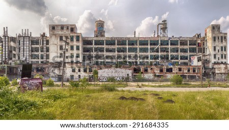 DETROIT, USA - JUNE 9, 2015: The Fisher Body Plant is now shut down and covered in graffiti but was used in automotive manufacturing until 1984. The building was designed by Albert Kahn in 1919.  - stock photo