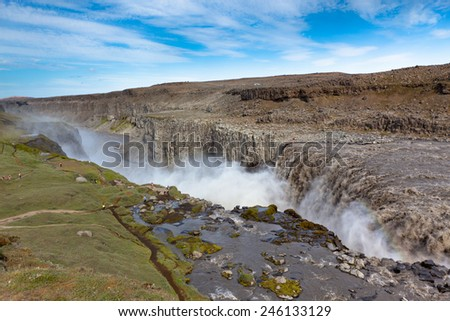 Dettifoss Waterfall in Iceland under a blue summer sky with clouds. Horizontal shot