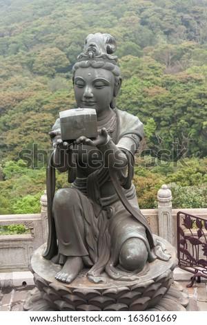 deva statue at Po Lin monastery in Hong Kong - stock photo