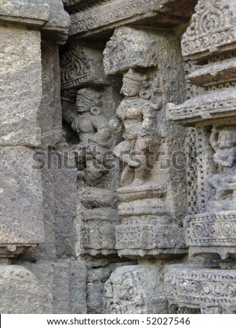 Devadasis, temple dancers, carvings on weathered red sandstone