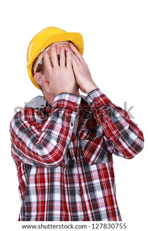 Devastated construction worker - stock photo