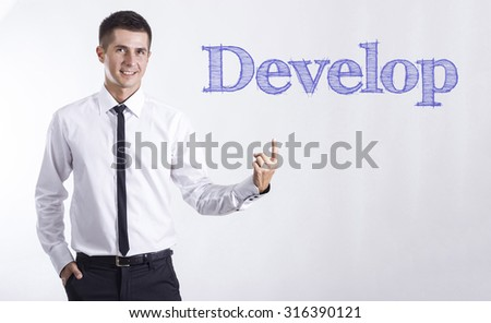 DEVELOP - Young smiling businessman pointing on text