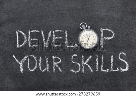 develop your skills phrase handwritten on chalkboard with vintage precise stopwatch used instead of O - stock photo