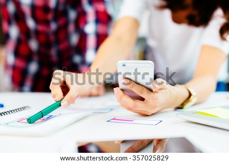 Developing mobile application for new startup - stock photo