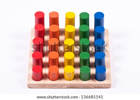 Developmental Toy: Bright Multi-Colored Cylinders - stock photo