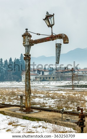 Device for pouring water in the locomotive is standing at the station the country's oldest narrow-gauge railway - Bansko, Bulgaria - stock photo