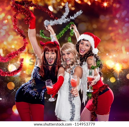 devil, angel and santa dancing together - stock photo