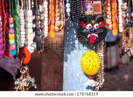 Devil black face amulet, jewelries and souvenirs in Gokarna citry market, Karnataka, India    - stock photo