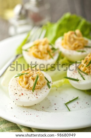 Devil eggs with lettuce in a plate - stock photo