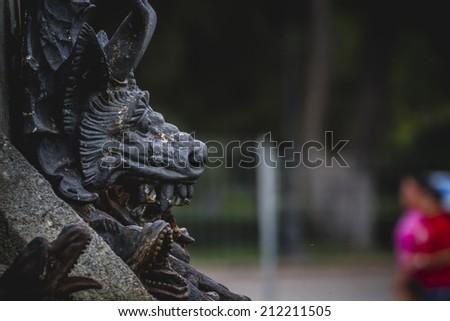 devil figure, bronze sculpture with demonic gargoyles and monsters - stock photo