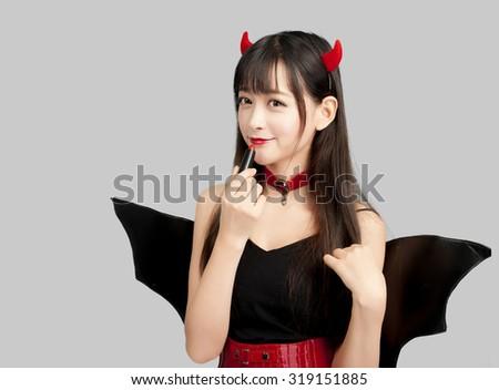 devil girl cosplay Halloween woman sexy glamour  - stock photo