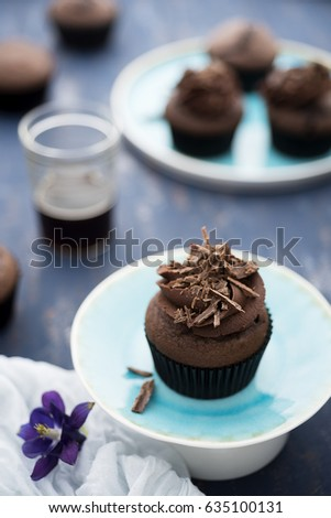 Devil's food cupcakes with a cup of coffee