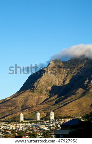 Devil's peak in Cape Town with the city in the foreground. - stock photo