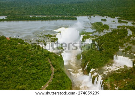 Devil's Throat - largest waterfall of the Iguazu Falls. Iguazu River spreads widely among the dense tropical forests. Picture taken from a helicopter - stock photo