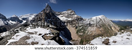 Devil's Thumb Hike, Mount Lefroy (left), Mount Victoria, Mount White (center), Mount Niblock, Mount St. Piran (right) Lake Louise, Banff National Park, Alberta, Canada Picture taken on August 22, 2015 - stock photo
