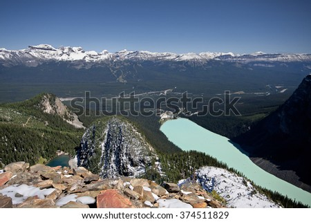 Devil's Thumb Hike, Scramble Lake Louise, Banff National Park, Alberta, Canada Lake Louise Ski Resort can be seen across the valley. Picture taken on August 22, 2015 - stock photo