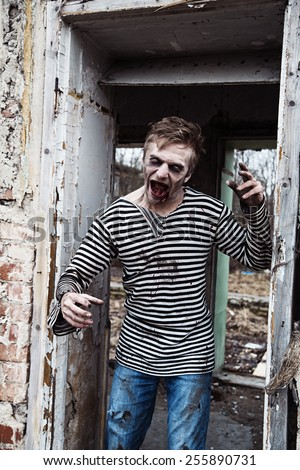 Devilish zombie man gone crazy with mutagen - stock photo
