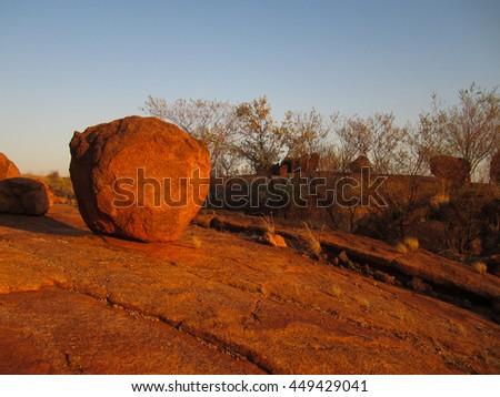 Devils red rocks in red center, Australia - stock photo