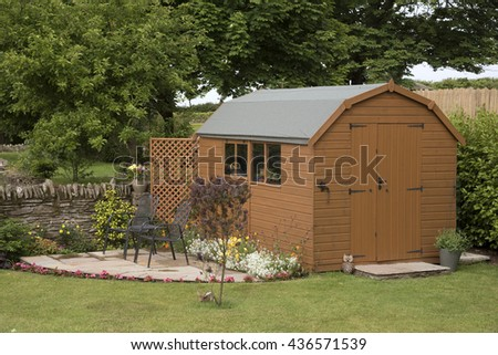 devon england uk june 2016 a barn style garden shed with a small patio