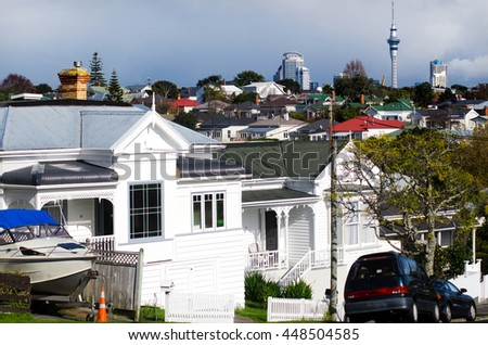 DEVONPORT, NZ - MAY 30 2013:Auckland CBD skyline as seen from Devonport. The suburb hosts the Naval Base of the Royal New Zealand Navy but is best known for its charming lifestyle.