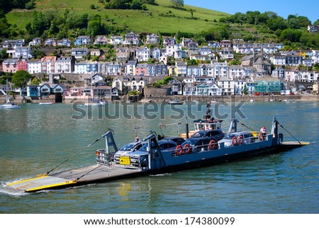 DEVONSHIRE,UK - JULY 9 : The Kingswear to Dartmouth ferry on July 9, 2013 in Devonshire, UK. The ferry is the quickest way to cross the River Dart and avoids a lengthy road journey. - stock photo