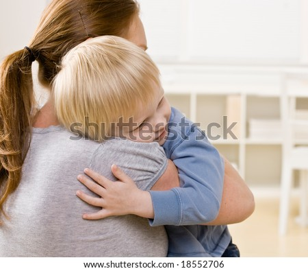 Devoted mother hugging and comforting her son