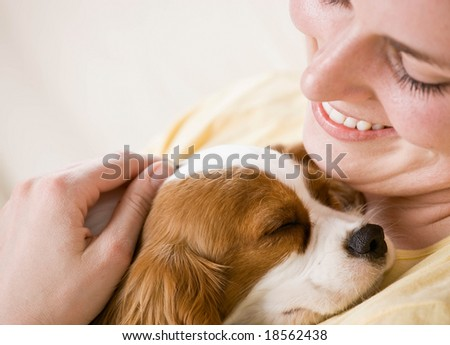 Devoted woman hugging and comforting pet dog