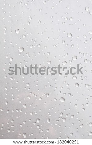 Dew drop on the silver car - stock photo
