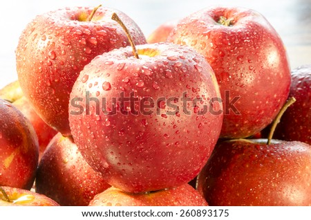 Dew drops on the surface of sweet apples - stock photo