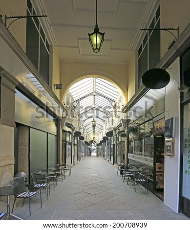 DEWSBURY, UK -JUNE 16: Arcade, Dewsbury, West Yorkshire, England, UK, 16 June 2014. Dewsbury, after a period of decline, is redeveloping derelict mills into flats and regenerating city areas.  - stock photo