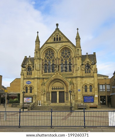 DEWSBURY, UK -JUNE 16:Church, Dewsbury, West Yorkshire, England, UK, 16 June 2014. Dewsbury,  after a period of decline, is redeveloping  derelict mills into flats and regenerating city areas. - stock photo