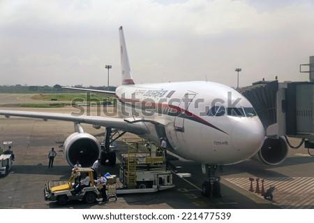 DHAKA, BANGLADESH - AUGUST 30: Biman Bangladesh Airlines A310 in Shahjalal International Airport on August 30, 2014. - stock photo